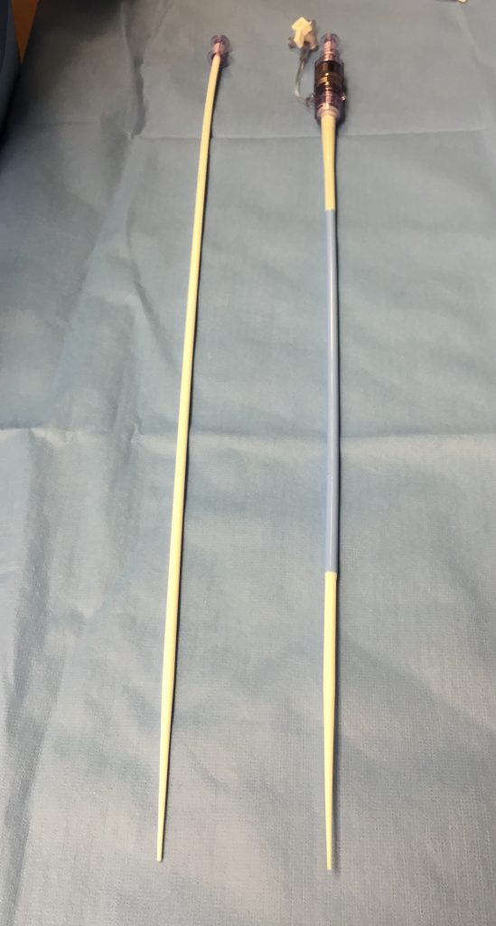 Dilator and sheath. This is a picture of a dilator and a sheath for a TAVR procedure. The dilator is the long thin white tube that is inserted in to the artery over a wire and dilates the artery preparing it for the large sheath. The sheath is the blue tube that is placed in the body through which the TAVR procedure valve is passed in to the body.