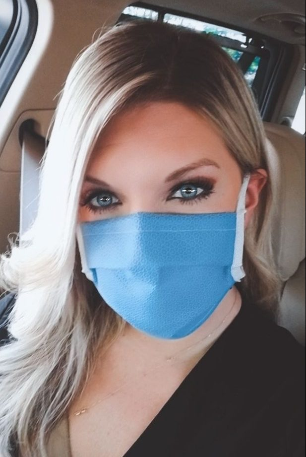 Woman modeling the N99 mask.