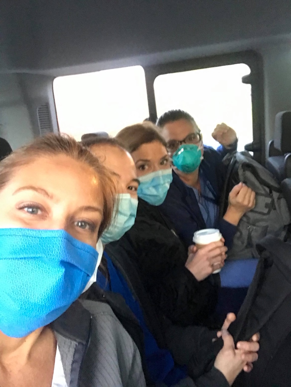 Group of medical professionals in N99 masks.