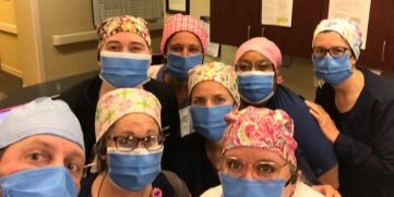 Medical professionals wearing N99 surgical masks.