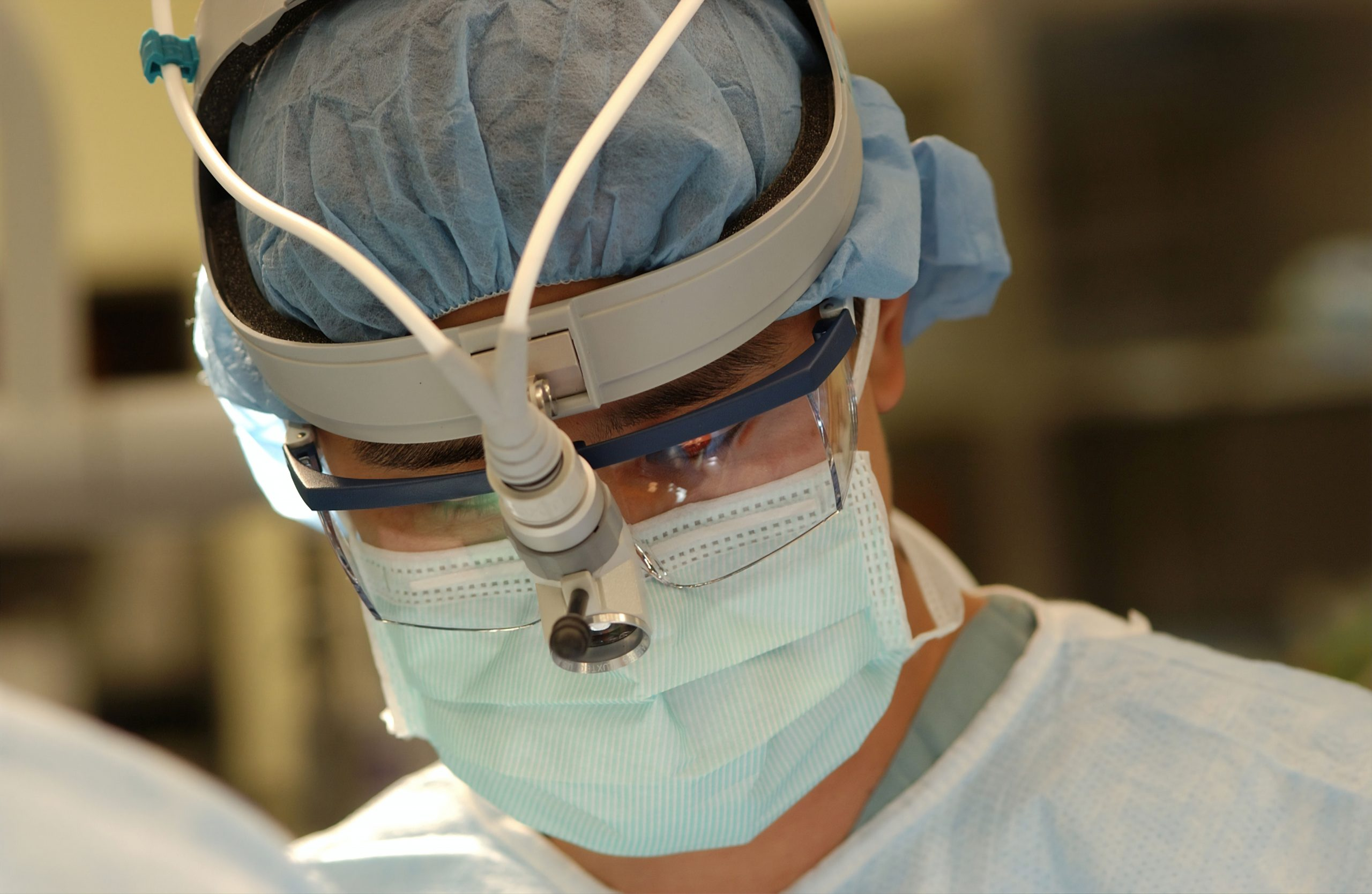 Surgeon who could be administering a heart transplant.