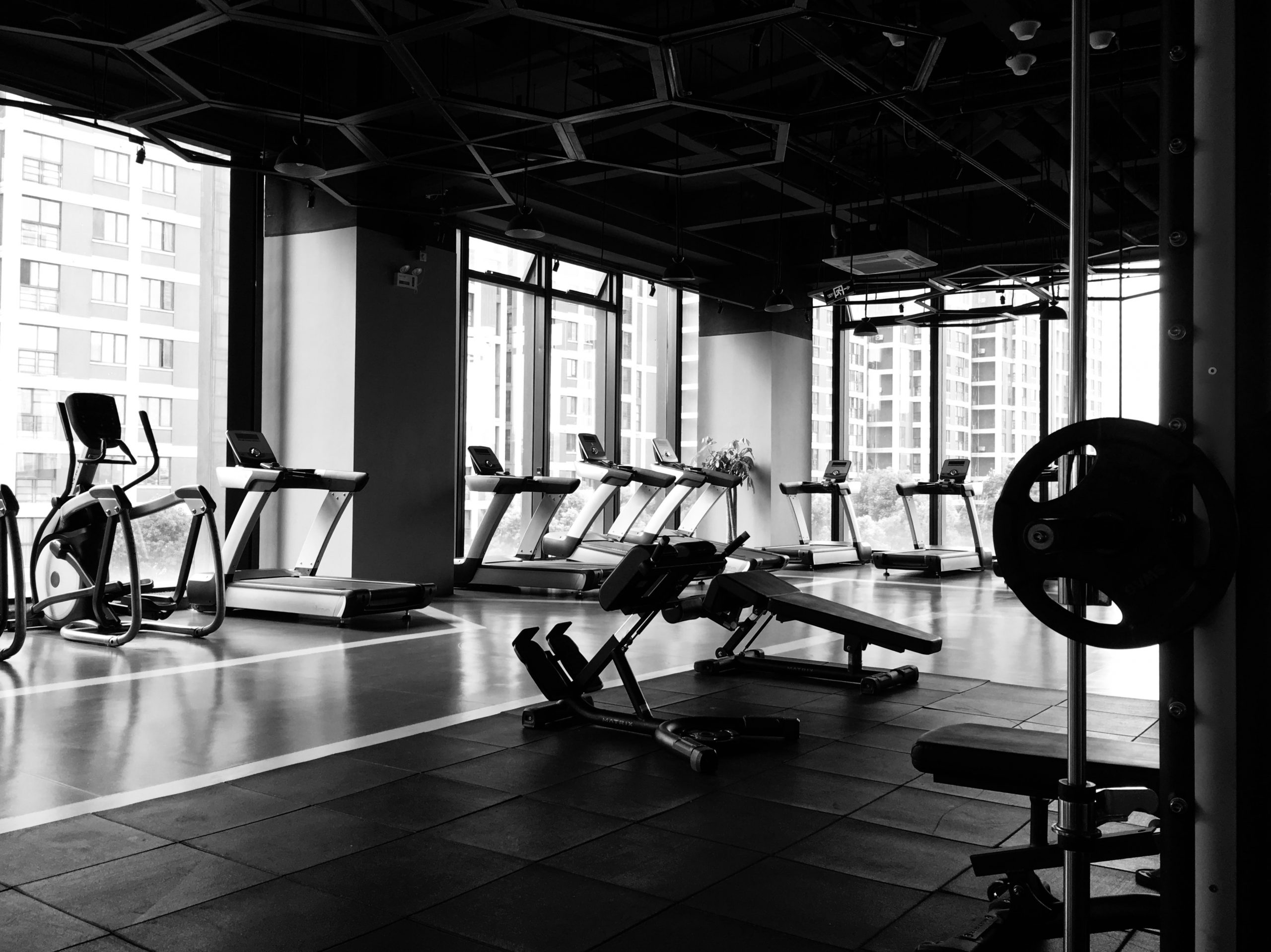 A black-and-white photo of a gym.