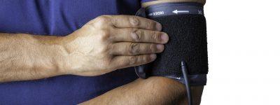 Man using a blood pressure cuff.