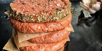Burger patties made from a plant-based meat substitute.
